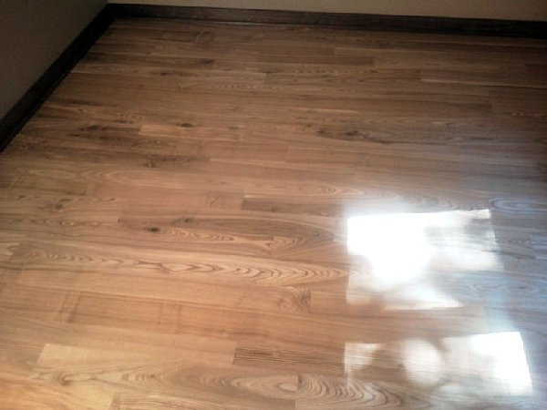 A beautiful black ash, wide plank floor we built.