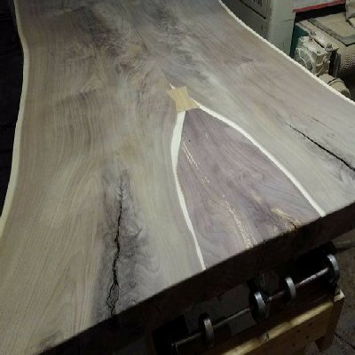Use wood bow ties, epoxy, inlays, etc to enhance the surface