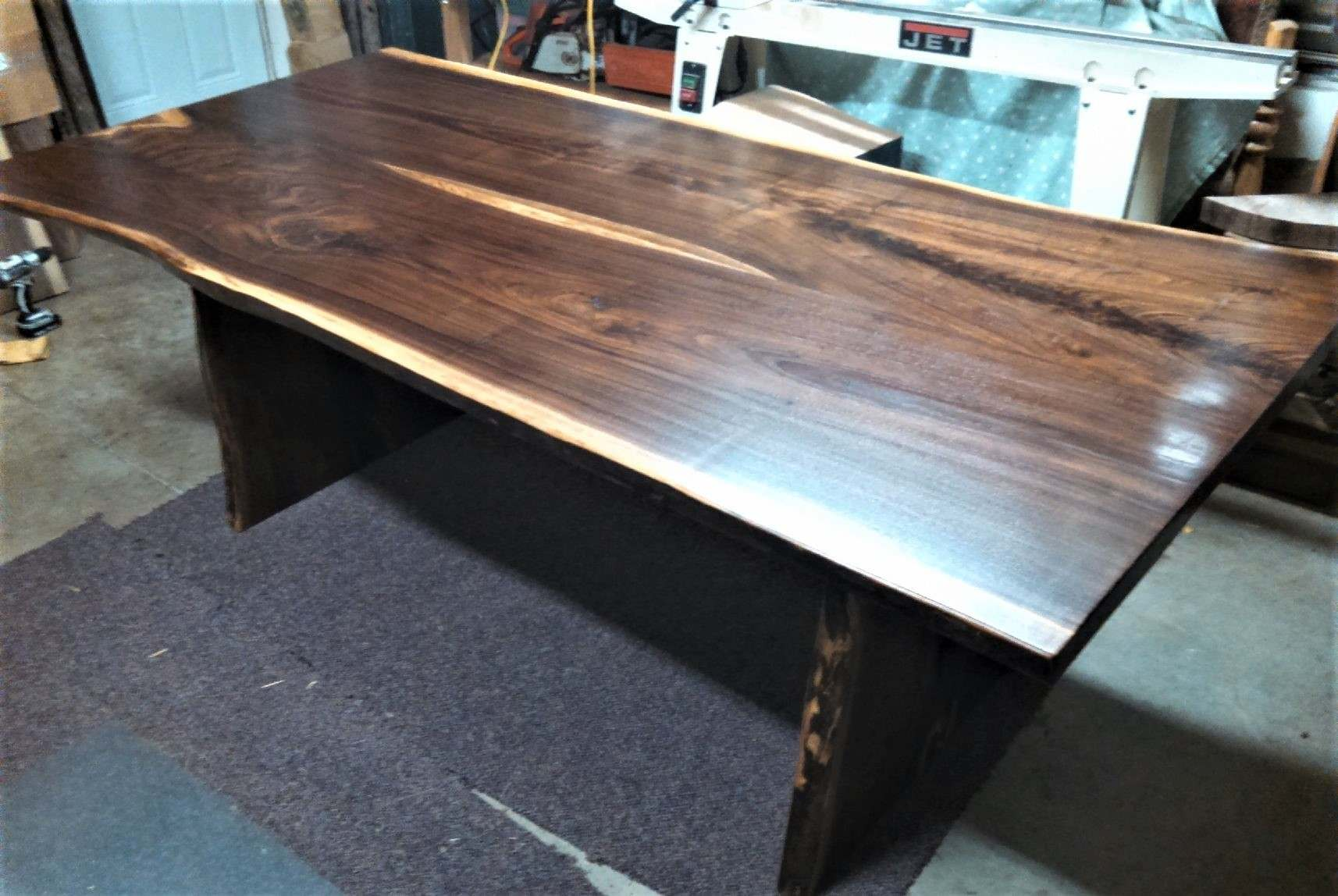 Bookmatched walnut live edge dining table